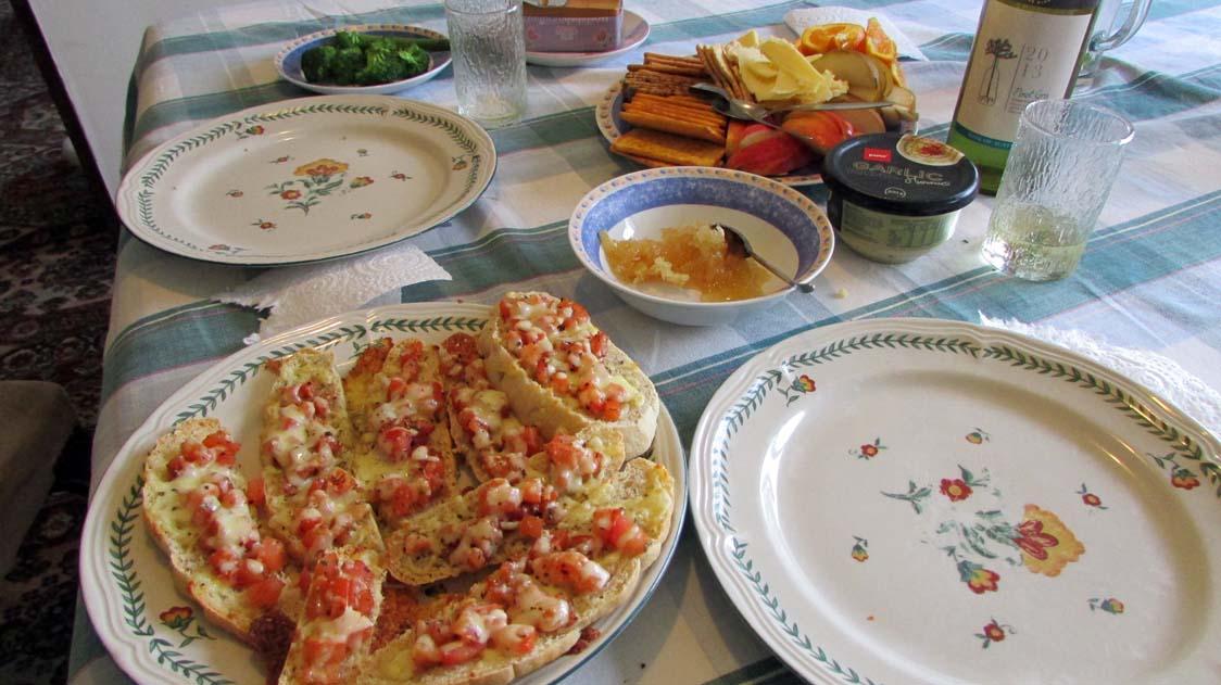 Bruchetta on homemade rosemary bread, three types of cheese, fruit, raw honey and wine for dinner!